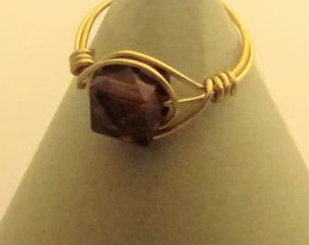 Wire wrapped ring with topaz glass bead