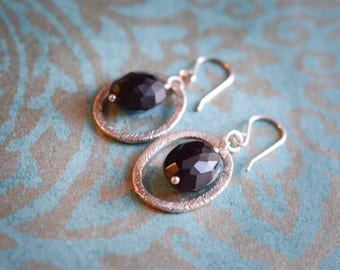 Sterling silver earrings with facetted black onyx