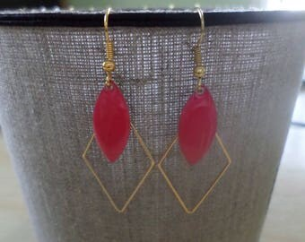 Gold tone red diamond earring