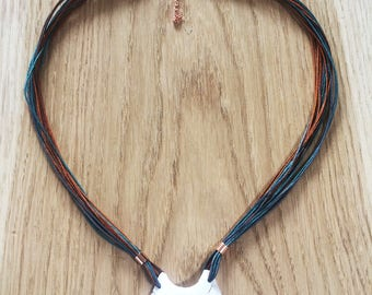 Macrame necklace with grey/brown/turquoise shell pendant