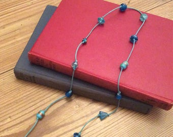 Handmade corded blue glass necklace
