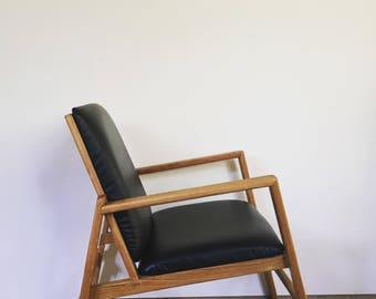 Black leather and oak lounge chair