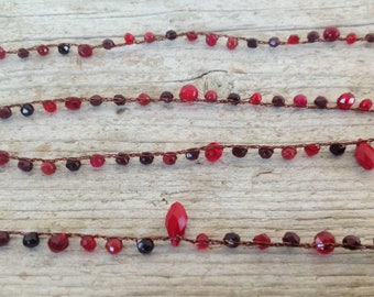 Long crochet necklace with copper-colored wire and ruby root beads, red jasper and Crystals