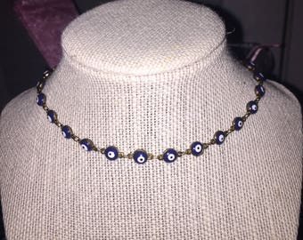 Navy blue evil eye choker