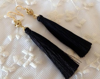 Silver 925 Gold bath earrings and black tassels.
