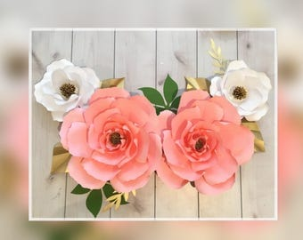 Two pink paper flowers