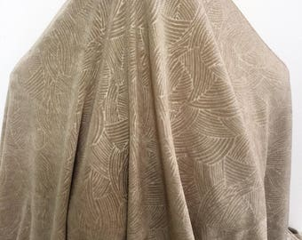 17-259 Dark Beige Stamped Pattern Slinky Knit - Sold by the Yard