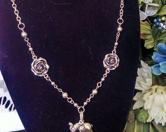Silver Rosette Elephant Pendant Necklace