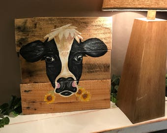 Cow head painting on pallet wood