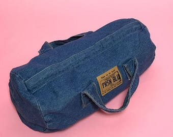 Denim cylinder mini duffel bag
