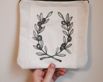 Goodwill | relief carving | canvas pouch