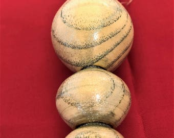 Christmas wooden bauble , shiny with gorgeous grain