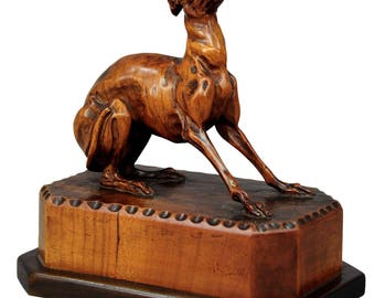 a fine carved statue of a staghound, circa 1890
