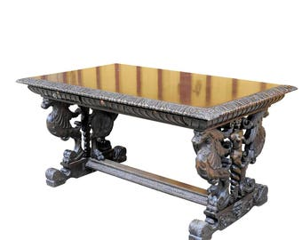 a great renaissance style desk with elaborate carvings