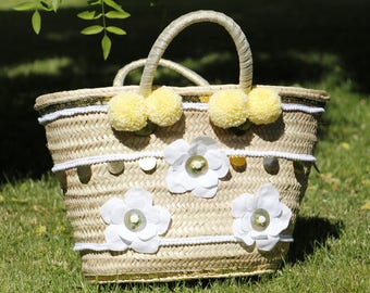 Yellow basket with white flowers