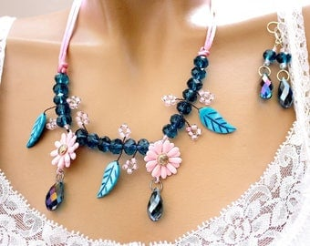 Pink and blue flower adornment Prussian beads on brass wire.