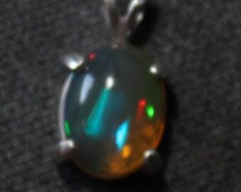 Sterling silver Ethiopian  Mezezo opal pendant 11 x 8.5 mm, 1.96 ct