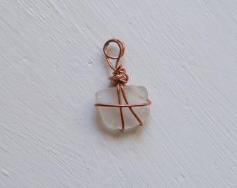 Copper wire wrapped clear seaglass pendant
