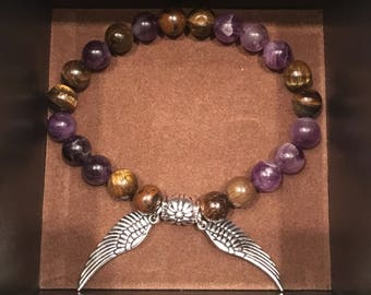 Purple and Tan with wing detail bead bracelet