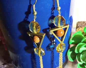 Gold stone accented dangle earrings with gold filled tassel accent and glass beading