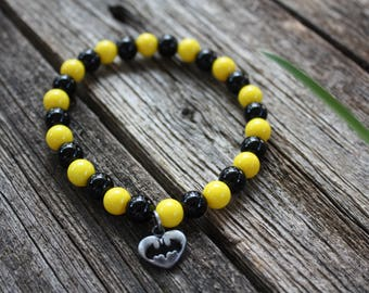 Batman Charm Stretch Bracelet w/Black & Yellow Solid Glass Beads.