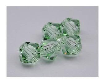 Pale green - 8 mm: 2 beads Chrysolite Swarovski Crystal bicone