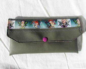 "Case in everything! faux leather, decorated with braid ""fairies"" and an embroidery machine."