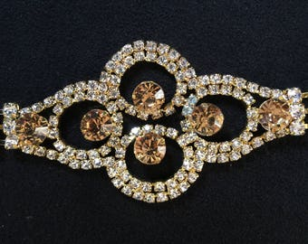 Applied rhinestones shine brilliantly with quality rhinestones crystal color and big rhinestone metal gold