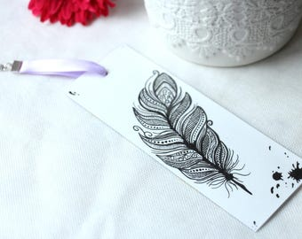 White bookmark with black feather and Purple Ribbon
