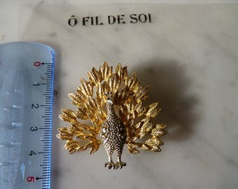Gold tone and rhinestone Peacock: brooch or pendant