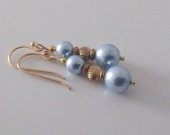 Low price: round Swarovski Pearl and gold plated brass bead