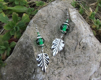 natural green and Silver earrings with charm leaf and handmade glass bead