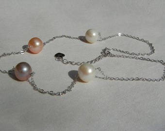 Silver chain and four freshwater cultured pearls