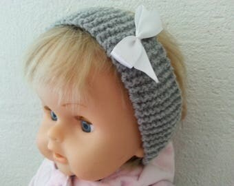 Grey embellished headband with a white satin bow