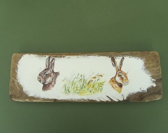 Head of rabbit and Hare on piece of wood head