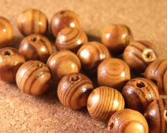 100 natural wooden beads striped from Peru - 10 x 9 mm - clear - B36B