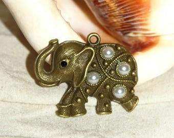 All bronze elephant pendant and 32 X 19 MM white pearls