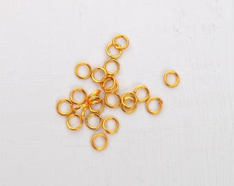 4 mm gold plated (5) jump rings
