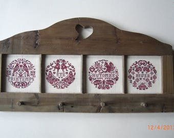 Four seasons-grey, framed in a wooden stand
