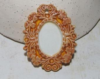 Orange rust pendant frame finish, ceramic
