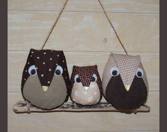owls family on a branch of wood