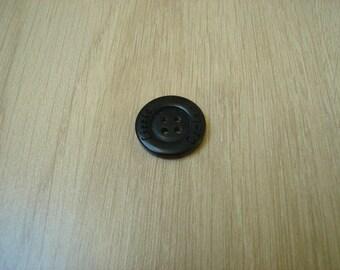black shape plastic button round