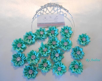 5 small turquoise flowers, satin, with Rhinestones.