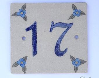 Number '17' sandstone and blue deco flower