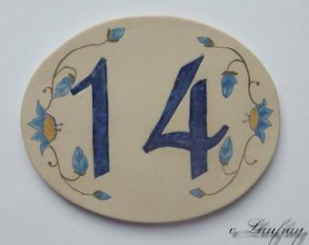 Original oval shaped, front door number, number 14 deco flower