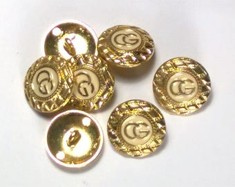Set of 7 metal gold and cream round buttons
