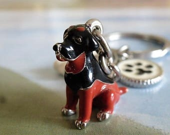 Keyring dog breed Rottweiler with accessories bone and ivory and black metal paw print enamel