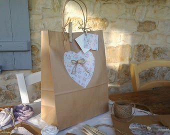 Four decorated kraft paper bags