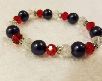 Red, blue, and clear glass bead bracelet
