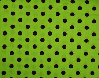 Purple background polka dot fabric lime green